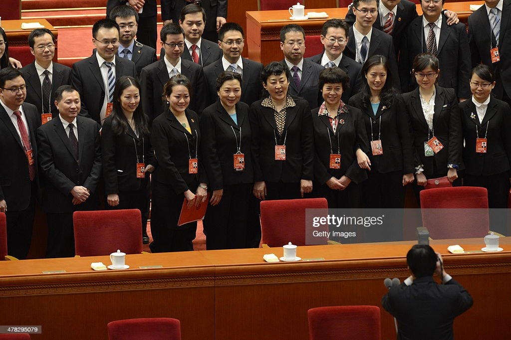 Delegates pose for a photograph after the closing ceremony of the second session of 13th National People's Congress (NPC) at the Great Hall of the People on March 13, 2014, in Beijing, China. China's parliamentary body, the second annual session of China's 12th National People's Congress (NPC), concluded its annual session this morning.