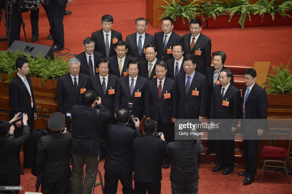 Delegates pose for photos after the closing session of the National People's Congress (NPC) at the Great Hall of the People on March 17, 2013 in Beijing, China. China's newly-elected president Xi Jinping pledged Sunday to resolutely fight against corruption and other misconduct in all manifestations.