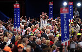 Delegates protest onm the floor on the first day of the Republican National Convention on July 18 2016 at the Quicken Loans Arena in Cleveland Ohio...