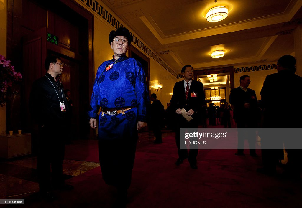 A delegates representing an ethnic minority stands inside the Great Hall of the People during the last day of the Chinese People's Political Consultative Conference (CPPCC) during the National People's Congress (NPC) in Beijing on March 13, 2012. The 2012 NPC session is the last before a handover of power that begins later this year, and leaders are anxious to ensure the world's second-largest economy grows at a steady pace while keeping a lid on social unrest. AFP PHOTO / Ed Jones