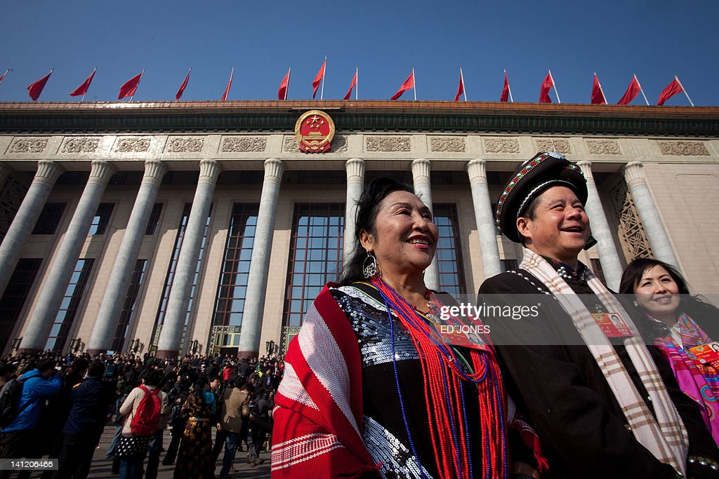 Delegates representing an ethnic minority walk outside the Great Hall of the People following the last day of the Chinese People's Political Consultative Conference (CPPCC) during the National People's Congress (NPC) in Beijing on March 13, 2012. The 2012 NPC session is the last before a handover of power that begins later this year, and leaders are anxious to ensure the world's second-largest economy grows at a steady pace while keeping a lid on social unrest. AFP PHOTO / Ed Jones