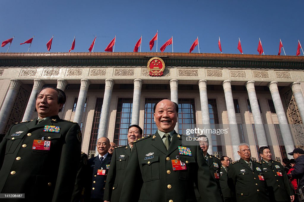 Delegates representing the People's Liberation Army (PLA) walk outside the Great Hall of the People following the last day of the Chinese People's Political Consultative Conference (CPPCC) during the National People's Congress (NPC) in Beijing on March 13, 2012. The 2012 NPC session is the last before a handover of power that begins later this year, and leaders are anxious to ensure the world's second-largest economy grows at a steady pace while keeping a lid on social unrest. AFP PHOTO / Ed Jones
