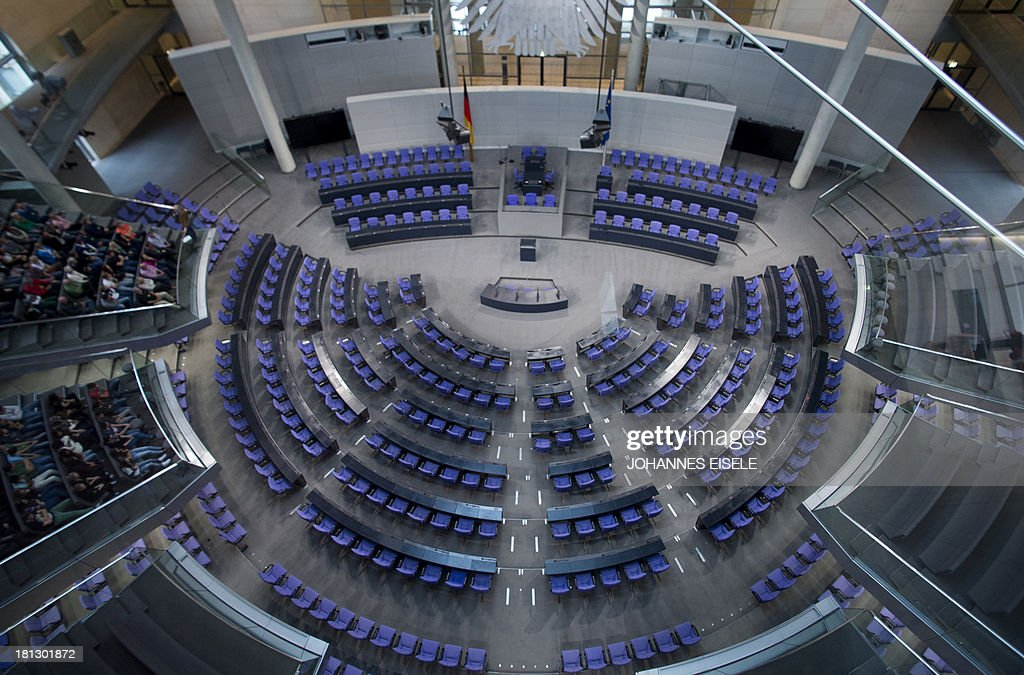 Delegates' seats are seen at the plenary hall of the German Bundestag (lower house of parliament) in Berlin is pictured on September 20, 2013. Germans go to the polls on September 22, 2013.
