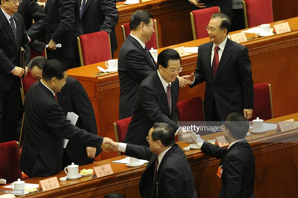 Delegates shake hands after the opening session of the Chinese People's Political Consultative Conference (CPPCC) at at the Great Hall of the People in Beijing on March 3, 2013. Thousands of delegates from across China meet this week to seal a power transfer to new leaders whose first months running the Communist Party have pumped up expectations with a deluge of propaganda.