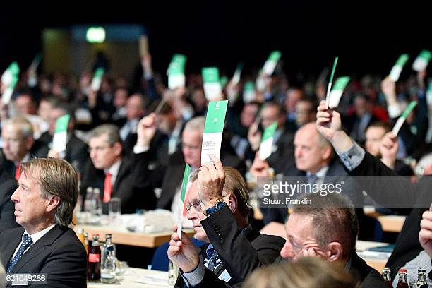 Delegates show their vote cards during day 2 of the 42nd DFB Bundestag at Messe Erfurt on November 4 2016 in Erfurt Germany