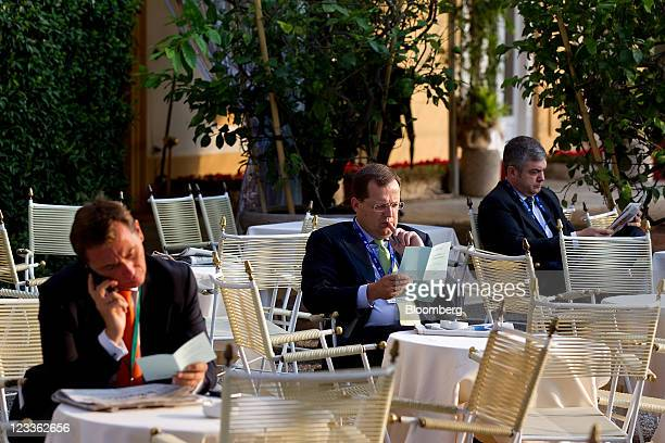 Delegates sit at tables in between sessions at the Ambrosetti Workshop in Cernobbio near Como Italy on Friday Sept 2 2011 The three day workshop...