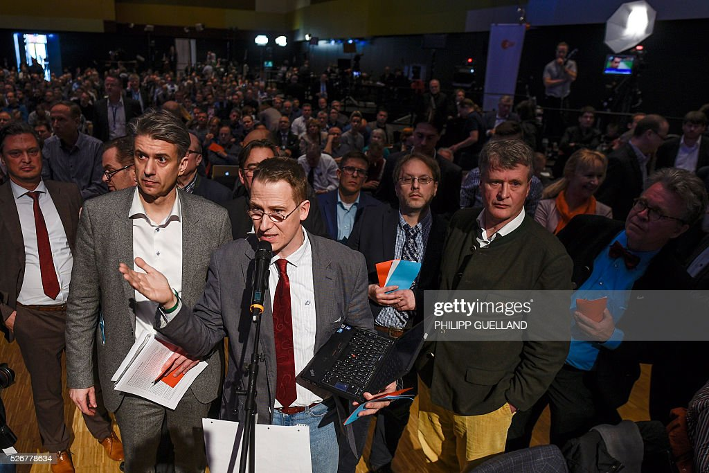 Delegates speak during a party congress of the German right wing party AfD (Alternative fuer Deutschland) at the Stuttgart Congress Centre ICS on May 1, 2016 in Stuttgart, southern Germany. / AFP / Philipp GUELLAND