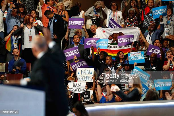 Delegates stand and cheer as California Governor Jerry Brown delivers remarks on the third day of the Democratic National Convention at the Wells...