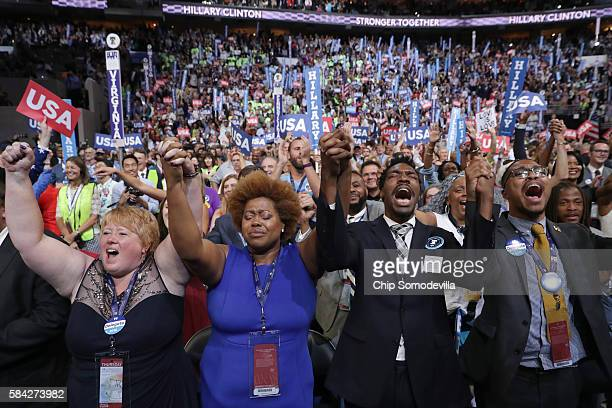 Delegates stand and cheer as Reverend William Barber delivers a speech on the fourth day of the Democratic National Convention at the Wells Fargo...