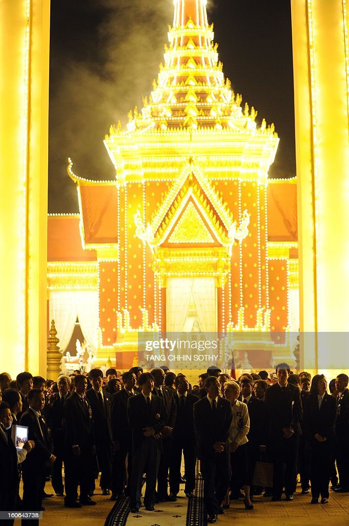 Delegates stand at the main gate during the cremation of Cambodia's King Norodom Sihanouk near the Royal Palace in Phnom Penh on February 4, 2013. Thousands of mourners massed in the Cambodian capital as the kingdom cremated its revered former King Norodom Sihanouk, who steered his country through six turbulent decades.