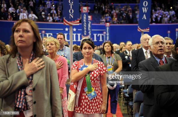 Delegates take part in the Pledge of Allegiance at the Republican National Convention in Tampa Florida US on Tuesday Aug 28 2012 Delegates are...