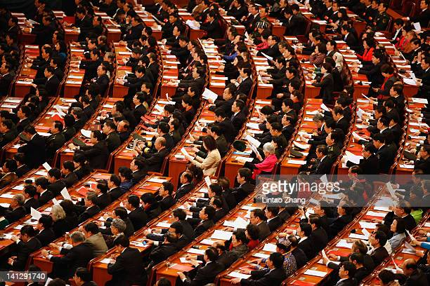Delegates take their seats for the closing session of the National Peoples Congress at The Great Hall Of The People on March 14 2012 in Beijing China...