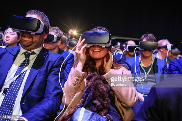 Delegates use the Gear VR headset manufactured by Samsung Electronics Co at the Samsung Unpacked launch event ahead of the Mobile World Congress in...