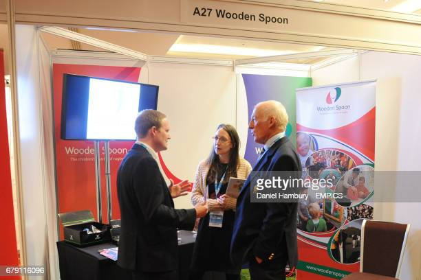 Delegates visit Wooden Spoon stand on Day 2 of Rugby Expo 2013 at Twickenham