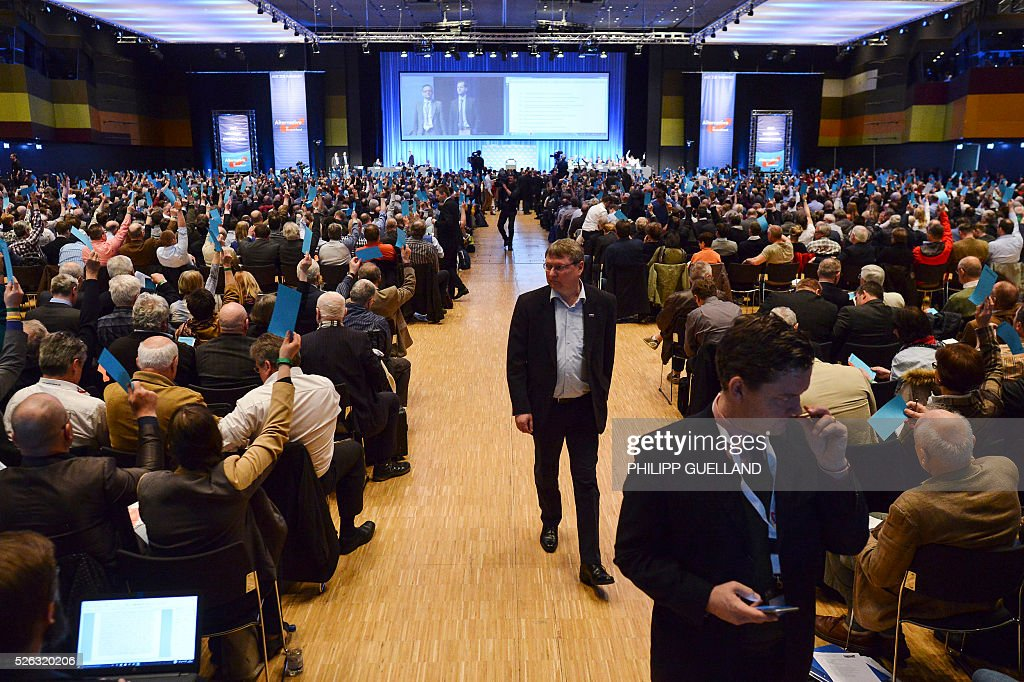 Delegates vote during a party congress of the German right wing party AfD (Alternative fuer Deutschland) at the Stuttgart Congress Centre ICS on April 30, 2016 in Stuttgart, southern Germany. The Alternative for Germany (AfD) party is meeting in the western city of Stuttgart, where it is expected to adopt an anti-Islamic manifesto, emboldened by the rise of European anti-migrant groups like Austria's Freedom Party. / AFP / Philipp GUELLAND