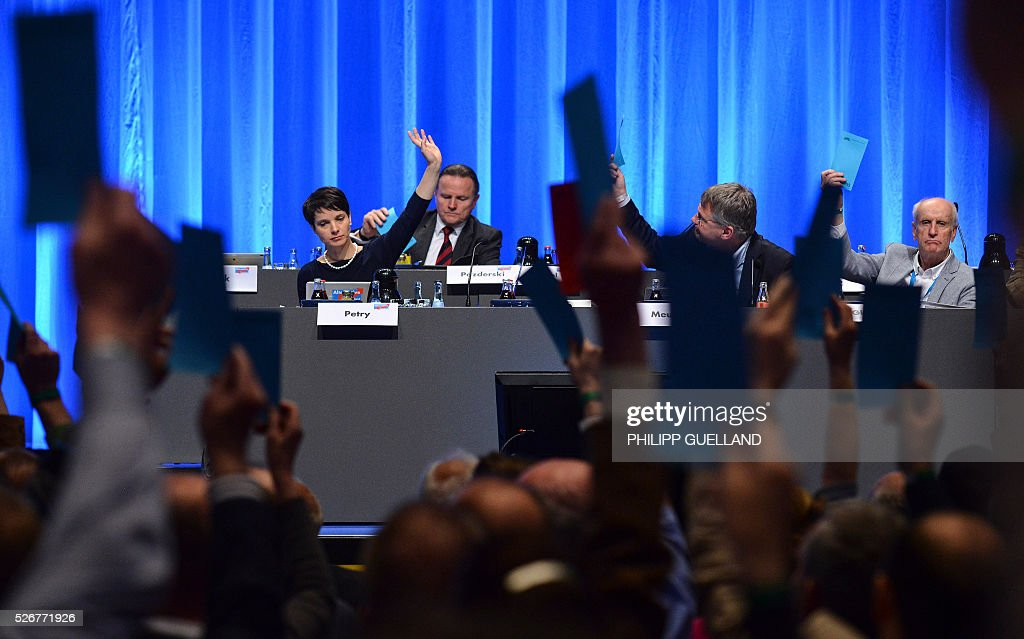 Delegates vote during a party congress of the German right wing party AfD (Alternative fuer Deutschland) at the Stuttgart Congress Centre ICS on May 1, 2016 in Stuttgart, southern Germany. / AFP / Philipp GUELLAND