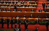 Delegates vote during the election of the new president of China during the 12th National People's Congress in the Great Hall of the People in...