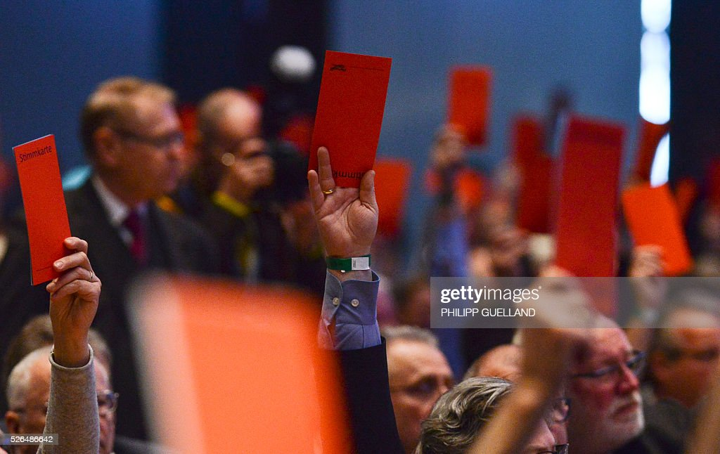 Delegates vote 'No' during a party congress of the German right wing party AfD (Alternative fuer Deutschland) at the Stuttgart Congress Centre ICS on April 30, 2016 in Stuttgart, southern Germany. The Alternative for Germany (AfD) party is meeting in the western city of Stuttgart, where it is expected to adopt an anti-Islamic manifesto, emboldened by the rise of European anti-migrant groups like Austria's Freedom Party. / AFP / Philipp GUELLAND
