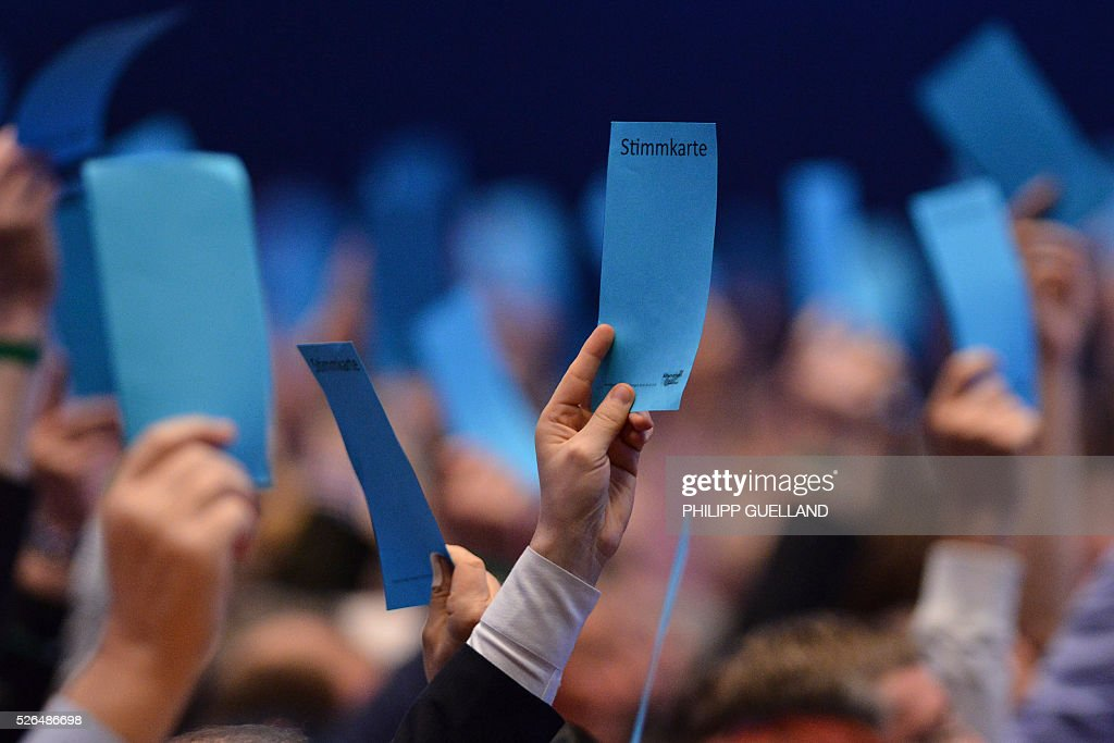 Delegates vote 'Yes' during a party congress of the German right wing party AfD (Alternative fuer Deutschland) at the Stuttgart Congress Centre ICS on April 30, 2016 in Stuttgart, southern Germany. The Alternative for Germany (AfD) party is meeting in the western city of Stuttgart, where it is expected to adopt an anti-Islamic manifesto, emboldened by the rise of European anti-migrant groups like Austria's Freedom Party. / AFP / Philipp GUELLAND
