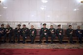 Delegates wait prior to the 3rd plenary session of the 12th National People's Congress at the Great Hall of the People in Beijing on March 12 2015...