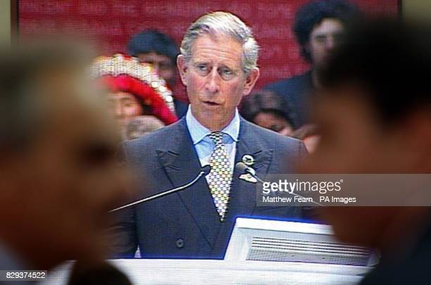 Delegates watch a big screen showing the Prince of Wales speaking at the Terre Madre conference in Turin Italy