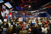 Delegates watch Republican presidential nominee Mitt Romney as he speaks during the 2012 Republican National Convention at the Tampa Bay Times Forum...