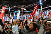 Delegates wave banners on the second day of the 2016 Democratic National Convention at Wells Fargo Center on July 26 2016 in Philadelphia...