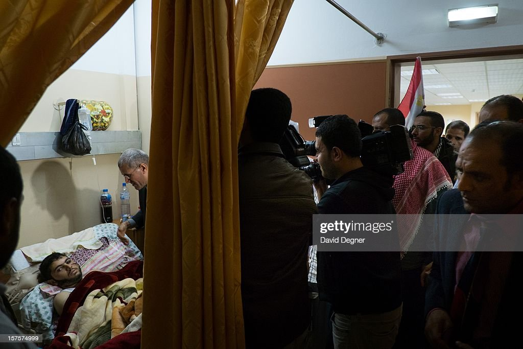 A delegation from Egyptian political parties, called the 'House of Families,' comes to take their picture with the wounded in the Shifa Hospital in Gaza City, Gaza on November 21, 2012. The hospital received many visiting delegations that roamed the halls showing their support for the Palestinian cause and the new internationalization of the enclave's cause.