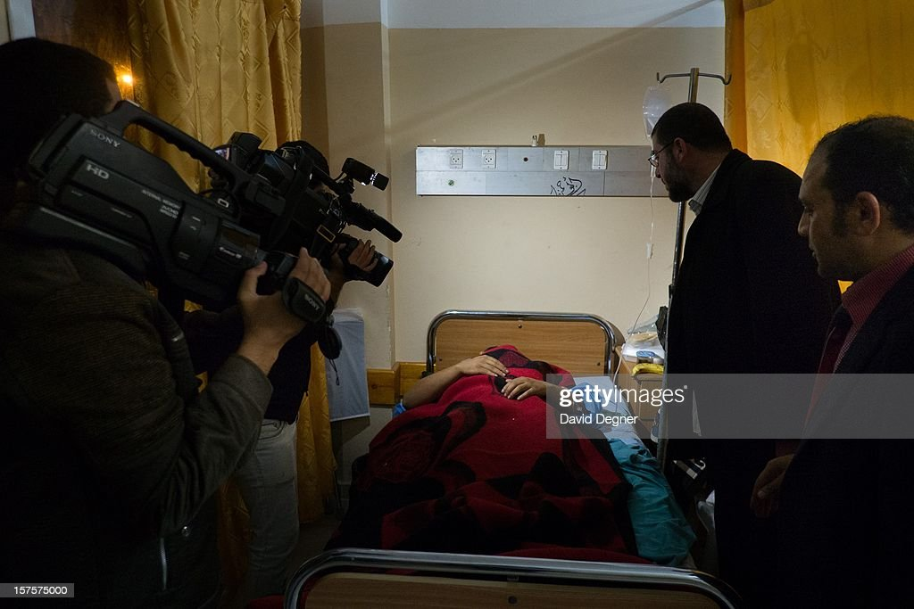 A delegation from Egyptian political parties, called the 'House of Families' comes to take their picture with the wounded in the Shifa Hospital in Gaza City, Gaza on November 21, 2012. The hospital received many visiting delegations that roamed the halls showing their support for the Palestinian cause and the new internationalization of the enclave's cause.
