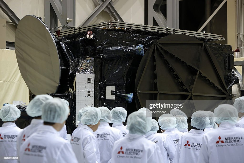 A delegation from Turkey inspect Turksat AS's Turksat-4A communications satellite, manufactured by Mitsubishi Electric Corp., during a ceremony marking at the company's satellite production facility at Kamakura Works in Kamakura, Kanagawa Prefecture, Japan, on Wednesday, Jan. 8, 2014. Turksat AS is Turkey's state-owned satellite operator. Photographer: Kiyoshi Ota/Bloomberg via Getty Images