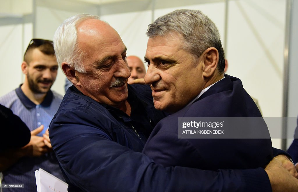 Delegation leader of Kosovo's Football Federation, Fadil Vokrri (R), celebrates the UEFA membership admission after the 40th Ordinary UEFA Congress at the Hungexpo Fair Center in Budapest, Hungary, on May 3, 2016. / AFP / ATTILA