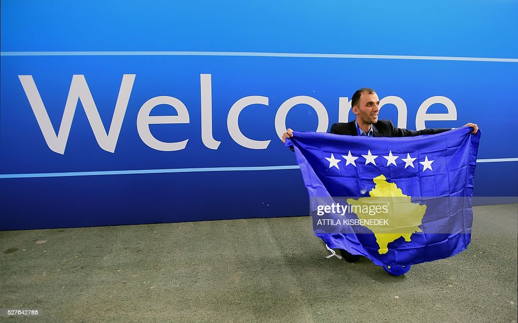 A delegation member of Kosovo celebrates the UEFA membership admission after the 40th Ordinary UEFA Congress at the Hungexpo Fair Center in Budapest, Hungary, on May 3, 2016. / AFP / ATTILA