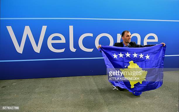 A delegation member of Kosovo celebrates the UEFA membership admission after the 40th Ordinary UEFA Congress at the Hungexpo Fair Center in Budapest...