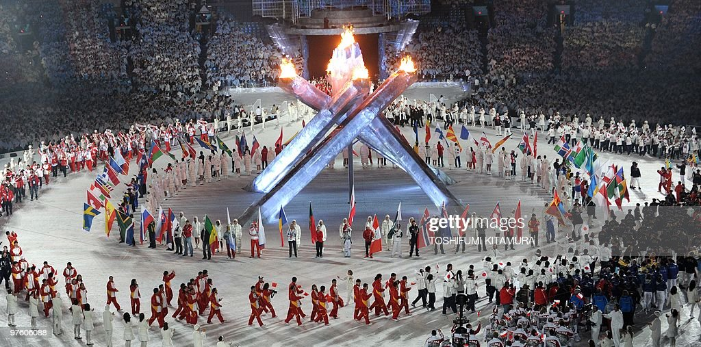 Delegation members march during the closing ceremony at the BC Place in Vancouver, on the last day of the 2010 Winter Olympics on February 28, 2010.