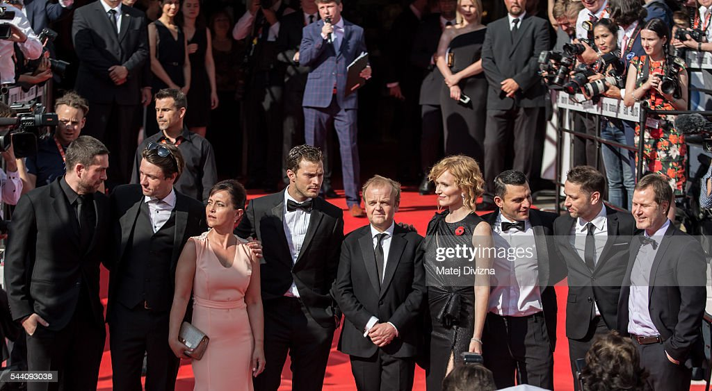 Delegation members of Anthropoid movie, including actors Jamie Dornan (4thL), Toby Jones (5thL) and director Sean Ellis (2ndR) pose for photographers as they arrive at the opening ceremony of the 51st Karlovy Vary International Film Festival (KVIFF) on July 1, 2016 in Karlovy Vary, Czech Republic.