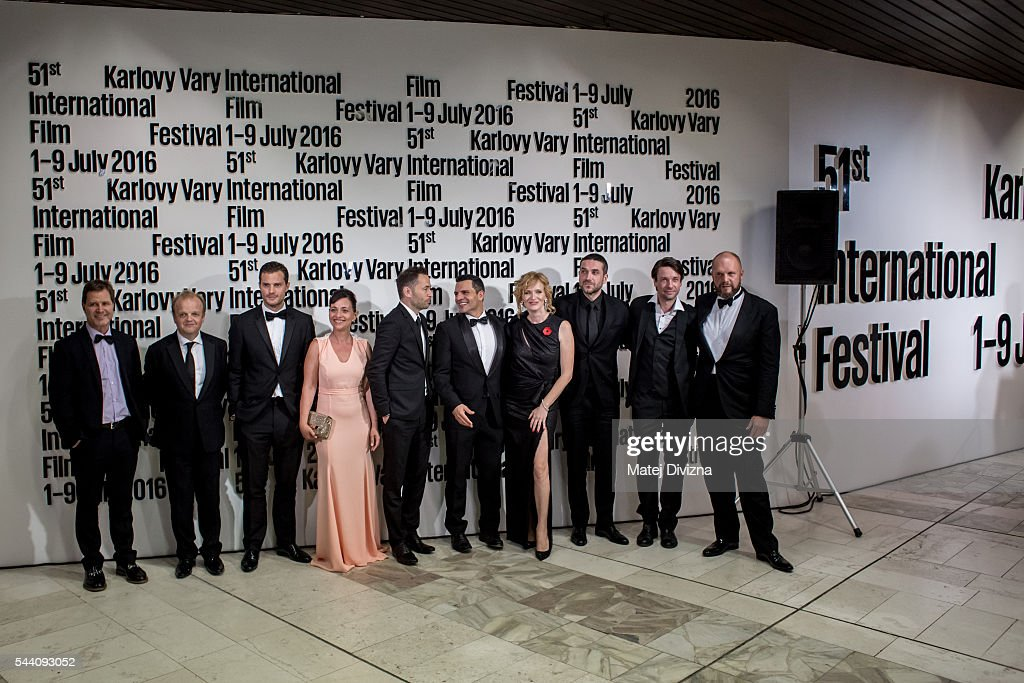 Delegation members of Anthropoid movie, including actors Jamie Dornan (3rdL) and Toby Jones (4thL), pose for photographers after world premiere of movie at the opening ceremony of the 51st Karlovy Vary International Film Festival (KVIFF) on July 1, 2016 in Karlovy Vary, Czech Republic.