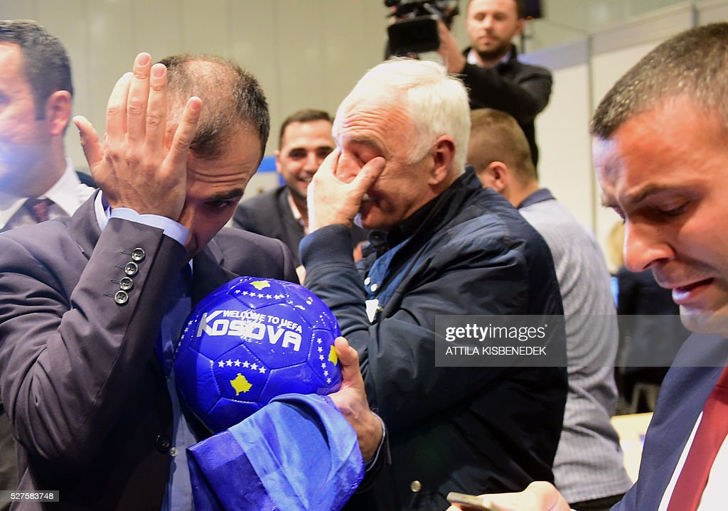 Delegation members of Kosovo celebrate their UEFA admission after the 40th Ordinary UEFA Congress at the Hungexpo Fair Center in Budapest, Hungary, on May 3, 2016. / AFP / ATTILA