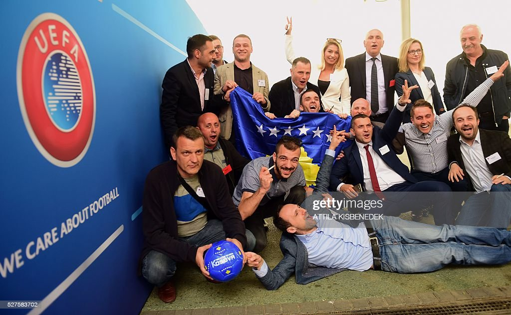 Delegation members of Kosovo celebrate their UEFA membership after the 40th Ordinary UEFA Congress at the Hungexpo Fair Center in Budapest, Hungary, on May 3, 2016. / AFP / ATTILA