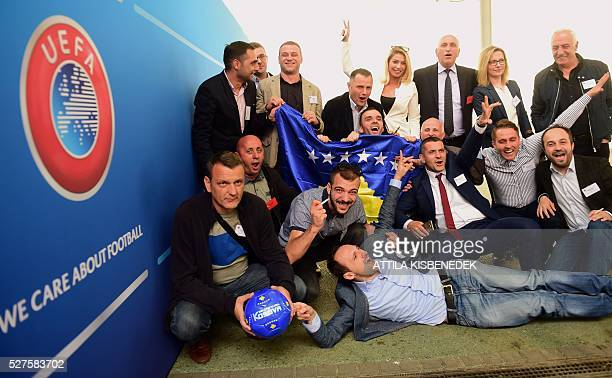 Delegation members of Kosovo celebrate their UEFA membership admission after the 40th Ordinary UEFA Congress at the Hungexpo Fair Center in Budapest...