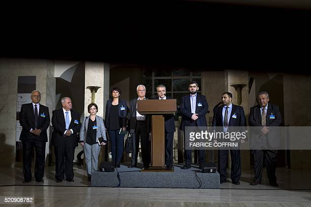 Delegation members of the main Syrian opposition body the High Negotiations Committee delegation head Asaad alZoabi delegate George Sabra and HNC...