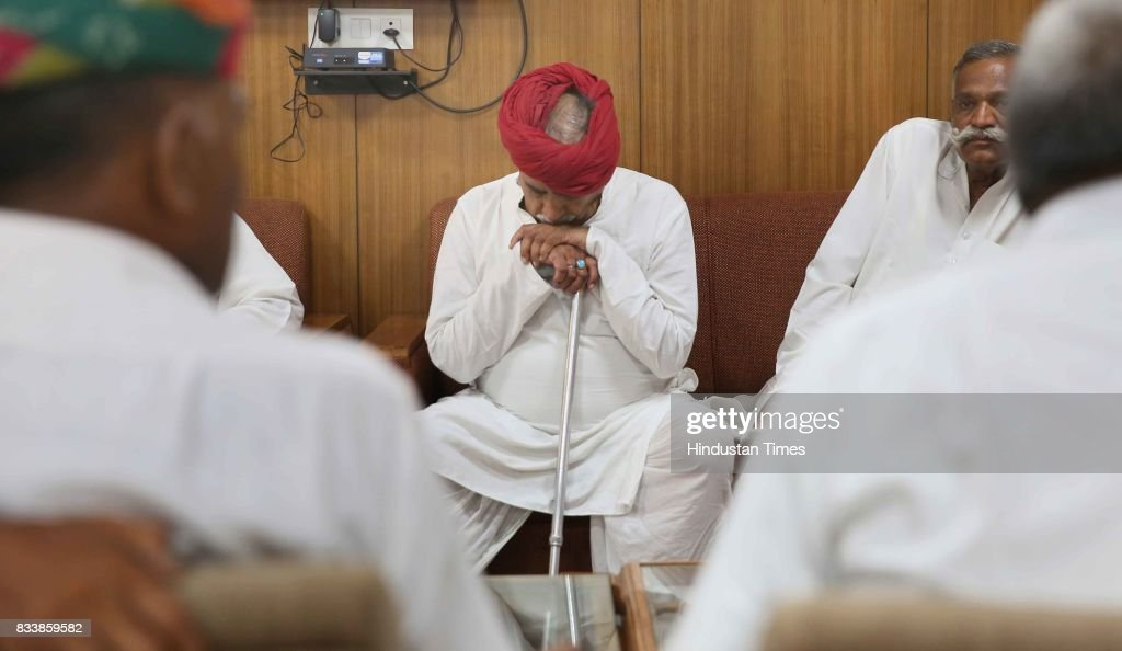 A delegation of Gujjar leaders, led by Col. Kirori Singh Bainsla (sitting in center), wait for government ministers before the meeting over the issue of Gurjar Reservation, at Indira Gandhi Panchaytiraj Institute on August 17, 2017 in Jaipur, India.