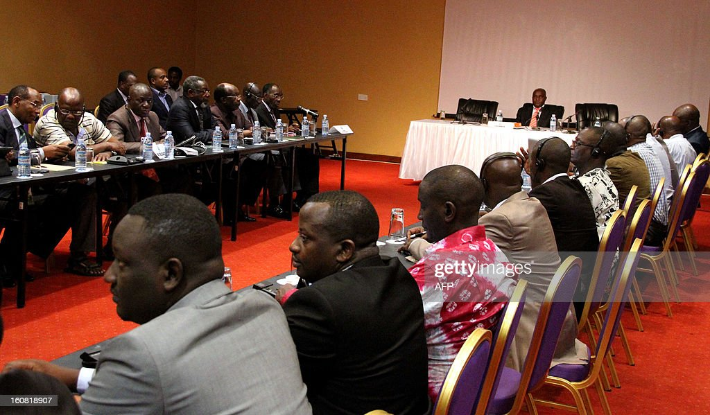 A delegation of M23 Congolese rebels (R) faces a delegation of the Democratic Republic of Congo (L) on February 6, 2013 during peace talks in Kampala. The government of the Democratic Republic of Congo and M23 rebels holding peace talks in Kampala on February 6 finalized a review of an earlier failed peace agreement, the first of four stages toward reaching a peace deal. M23 rebels were persuaded to withdraw from the key eastern city of Goma after a 12-day occupation, they still control large areas of territory just outside the strategic mining hub. The negotiations are the latest in several bids to end a long-running conflict that has forced hundreds of thousands of people in eastern DR Congo from their homes.