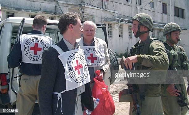 Delegation Of The Red Cross Speak With Israeli Soldiers As They Make Their Way To Visit Palestinian Leader Yasser Arafat April 6 2002 In The West...