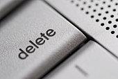 delete button on a silver laptop