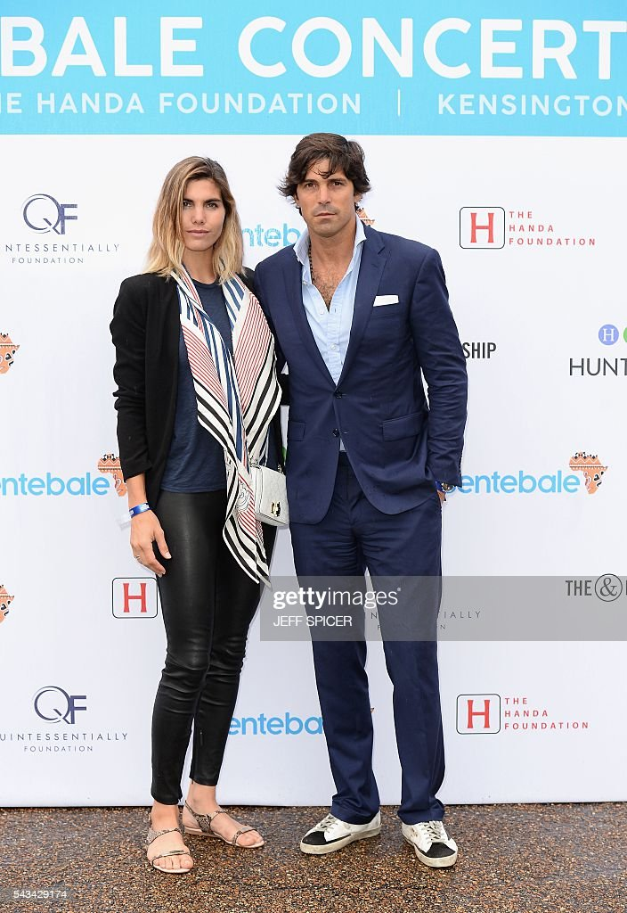 Delfina Blaquier and Nacho Figueras pose for photographers as they arrive to attend the Sentebale Concert at Kensington Palace in central London on June 28, 2016 in London. Prince Harry will be joined by co-founding Patron Prince Seeiso of Lesotho to watch the concert and will deliver a speech on stage during the evening. The event will raise funds to support Sentebale's work helping vulnerable young people in Lesotho and Botswana. / AFP / POOL / Jeff Spicer