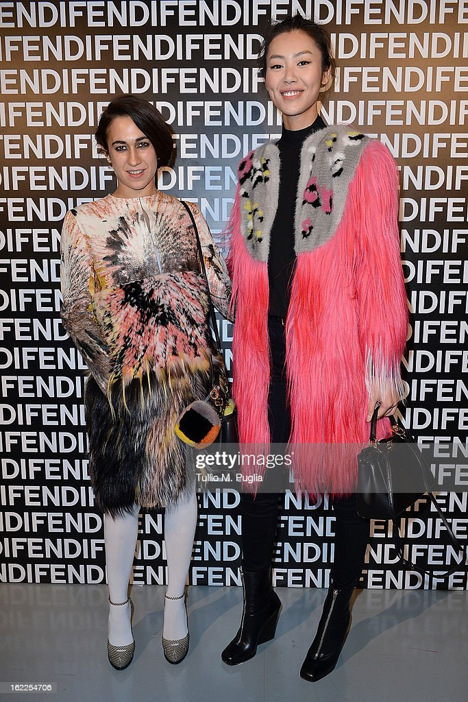Delfina Delettrez Fendi and Liu Wen attend the Fendi fashion show as part of Milan Fashion Week Womenswear Fall/Winter 2013/14 on February 21 2013 in...