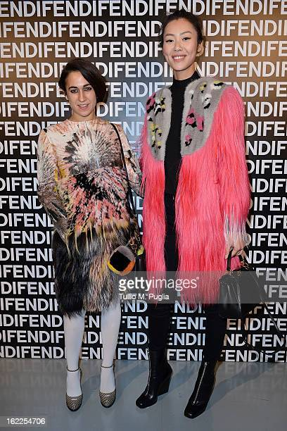 Delfina Delettrez Fendi and Liu Wen attend the Fendi fashion show as part of Milan Fashion Week Womenswear Fall/Winter 2013/14 on February 21 2013 in...