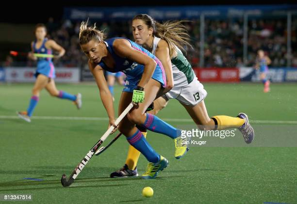 Delfina Merino of Argentina and LisaMarie Deetlefs of South Africa battle for possession during day 3 of the FIH Hockey World League Semi Finals Pool...