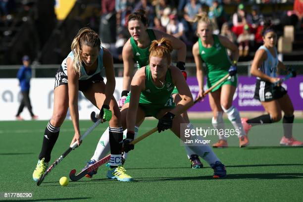Delfina Merino of Argentina and Zoe Wilson of Ireland battle for possession during the Quarter Final match between Argentina and Ireland during the...