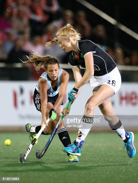 Delfina Merino of Argentina battles with Nina Notman of Germany during day 7 of the FIH Hockey World League Women's Semi Finals semi final match...